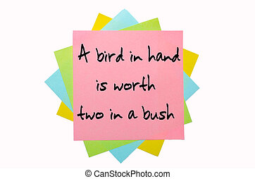 "text ""A bird in hand is worth two in a bush"" written by hand..."