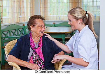 home care of old lady - a nurse home care visits a patient