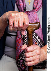 old and young hand with walking stick