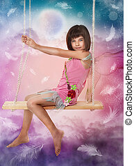 Little girl sitting on the swing