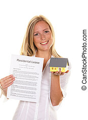 woman with a rental agreement in english - a young woman has...