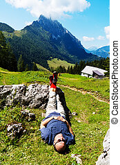 hikers relax at hike in the mountains - a hiker is...