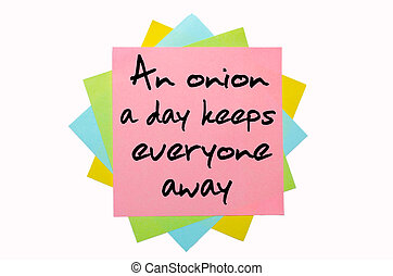 "text ""An onion a day keeps everyone away"" written by hand..."