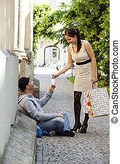 a rich woman gives a beggar money