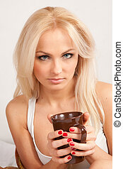 beautiful blonde is drinking coffee