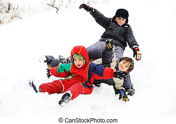 Group of children happily playing in snow, winter
