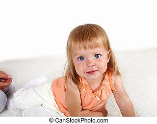 Little blond girl in studio