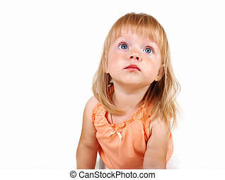 Little blond girl in studio
