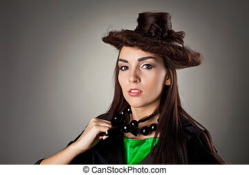 Woman portrait in hair style like hat
