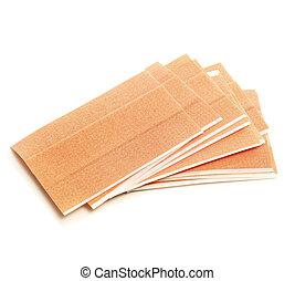 adhesive bandages - some adhesive bandages on a white...