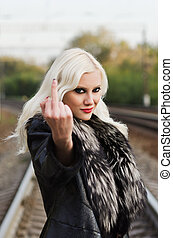 "Seductive young girl showing middle finger (""fuck off""..."