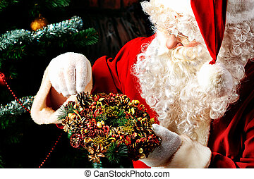 wreath - Santa Claus posing with presents over Christmas...