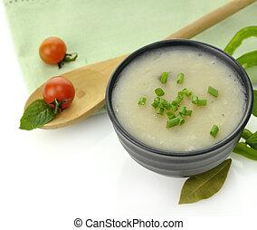 Potato Cream Soup In A Black Bowl