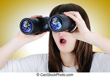 Girl with binoculars looking at the Earth