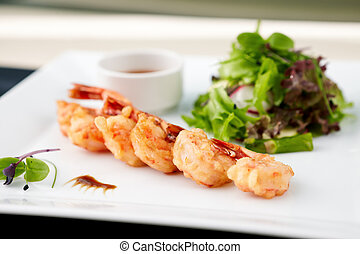 Tempura shrimps with garlic and chilli on a plate