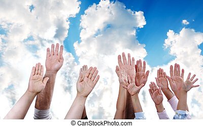 Many hands rising the sky together, children and adults