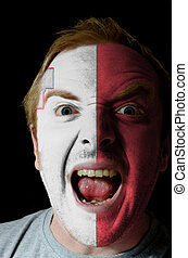 Face of crazy angry man painted in colors of malta flag -...