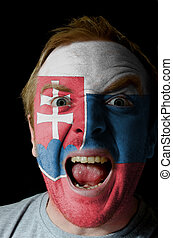 Face of crazy angry man painted in colors of slovakia flag -...