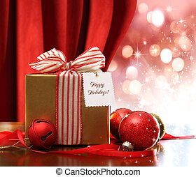 Gold Christmas gift box and ornaments with sparkle lights