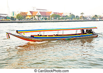 boats on the river Mae Nam Chao Phraya with sunrise in...
