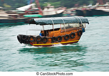 boat cruise with traditional wooden junk - tourists on a...