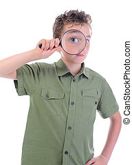 boy looking through a magnifying glass isolated on a white...