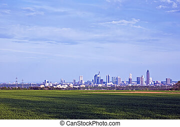 cityview of Frankfurt in spring over fields