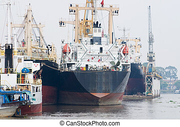 Cargo ships at port - Cargo ships moored at Saigon River in...
