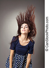 Beauty young woman retro style - hairs blow up