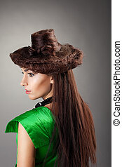 Woman portrait in hair style like hat on grey