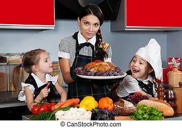 Christmas Dinner - mother with two daughters in the kitchen...