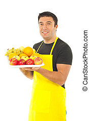 Greengrocer holding fruits - Greengrocer with yellow apron...