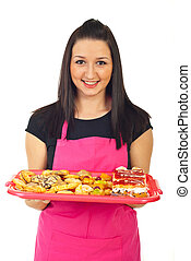 Confectioner holding cookies - smiling confectioner woman...