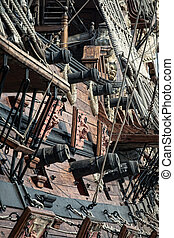 Old pirate ship on dockyard - retro style toned photo