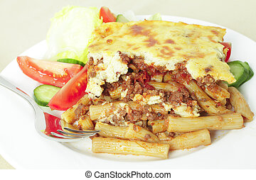 Pastitsio meal deep focus - Plate of pastitsio meat and...