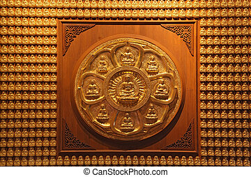 golden wheel of buddha on wall in dragon temple Thailand