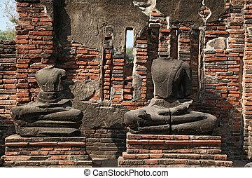 headless buddha statue in temple ruin , bangkok thailand