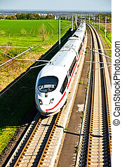 high speed train in open area - high speed train with full...