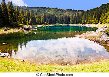 lake in Dolomites - Perfectly clear emerald lake in...