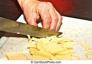 cutting food with knife in the kitchen - detail of cutting...
