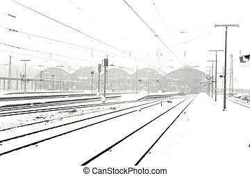 train in Wintertime on track in snow flurry - train in...