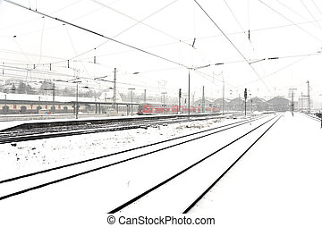 train in Wintertime on track in snow flurry - train in...