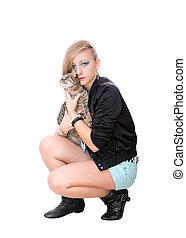 Beautiful girl with a cat in his hands