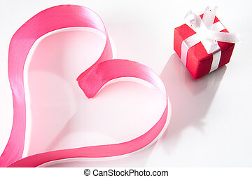 Token of love - Form of heart made up of pink ribbon with...
