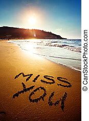 Miss You - Dramatic inscription Miss You on wet golden beach...