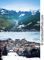 Aeral view down on Zell Am See (Austria, Alpes) town, frozen...