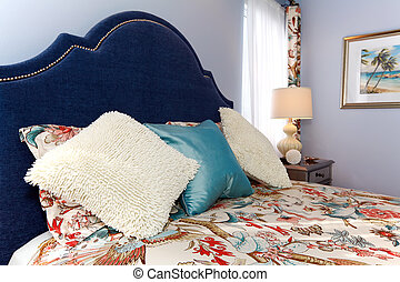 Bed with luxury pillows and sheets - Blue bedroom with...