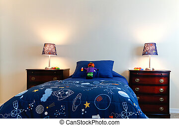 Blue boys bed with two lamps in a white bedroom