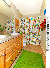 Bathroom with green rug, double sinks and bright shower...