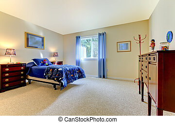 Boys large bedroom with blue bed and beige walls - Kids...